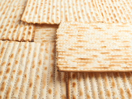 machine made: Surface covered with machine made matza flatbread as a background texture, shallow depth of field composition