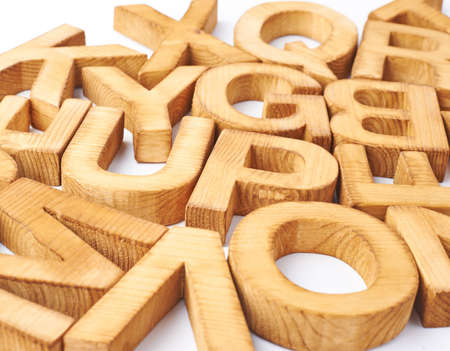 Surface covered with multiple wooden letters as a typography background composition photo