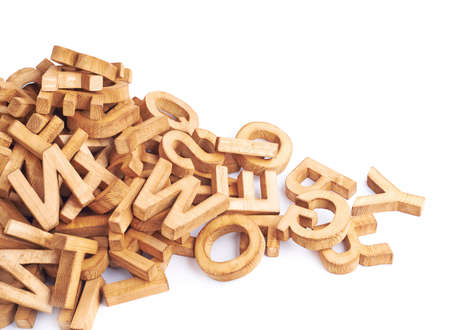 jumbled: Pile of wooden block letters isolated over the white background as a typography background composition Stock Photo
