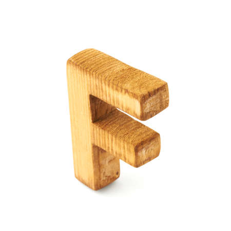 Single capital block wooden letter F isolated over the white background photo