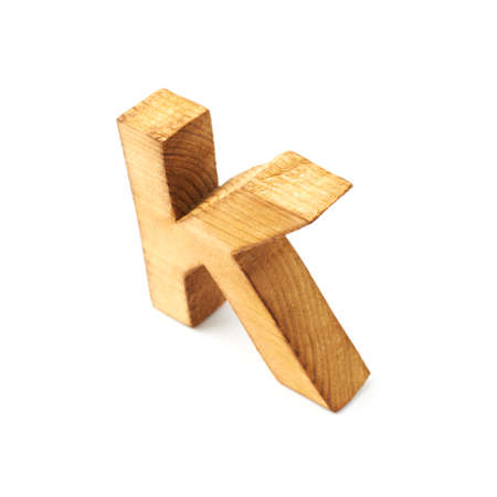 Single capital block wooden letter K isolated over the white background photo