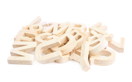 Pile of multiple wooden block letters isolated over the white background photo