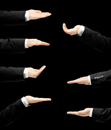 lowkey: Caucasian male hand in a business suit, opened palm gesture sign in seven versions, low-key lighting composition, isolated over the black background Stock Photo