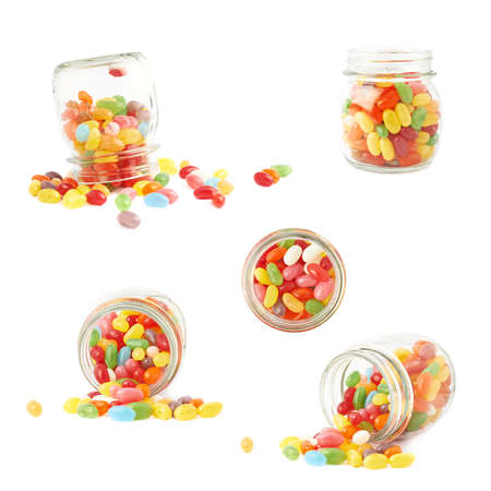 Composition of a glass jar and multiple colorful jelly bean candies, isolated over the white background, set of multiple foreshortenings photo