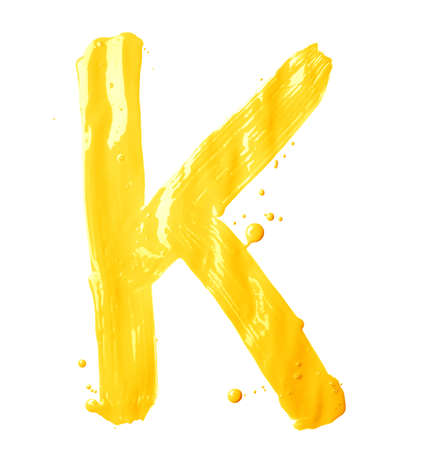 Letter K character hand drawn with the oil paint brush strokes, isolated over the white background photo