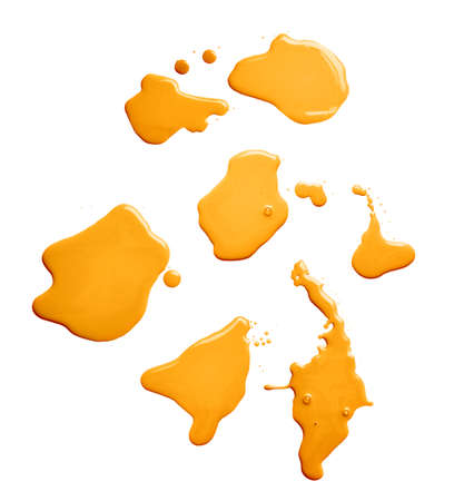 orange splash: Set of multiple puddles of an oil paint spill isolated over the white background, top view above