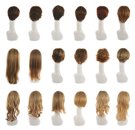 Hair wig over the white plastic mannequin head isolated over the white background, set of multiple different wigs in the back foreshortening Banque d'images
