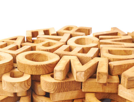 jumbled: Surface covered with multiple wooden letters as a typography background composition