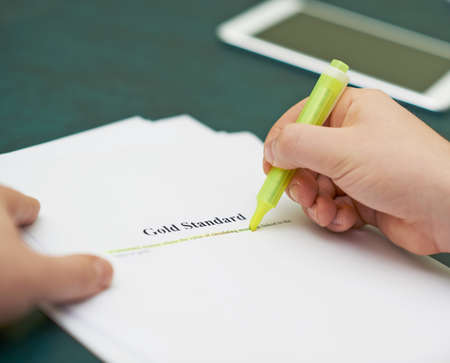 Marking words in a gold standart definition, shallow depth of field composition photo