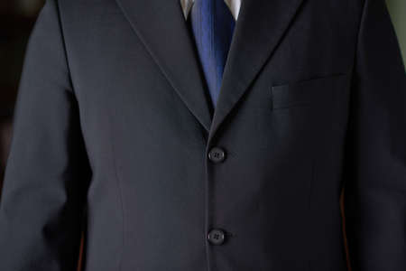 Close-up fragment of a man in a business suit, shallow depth of field composition photo