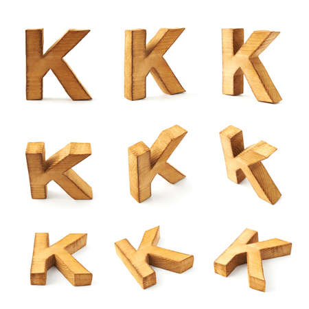 Set of nine block wooden capital K letters in different foreshortenings isolated over the white background photo
