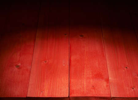 Red paint coated wooden boards copyspace background composition with the low key lighting photo