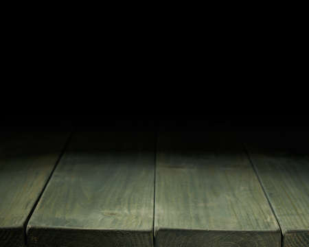 low key lighting: Dark green paint coated wooden boards copyspace background composition with the low key lighting