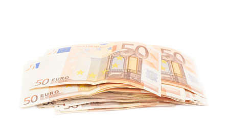messily: Stack pile of fifty euro bank notes isolated over the white background