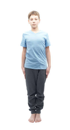 full shot: Full shot portrait of a caucasian 12 years old childen boy in a blue t-shirt