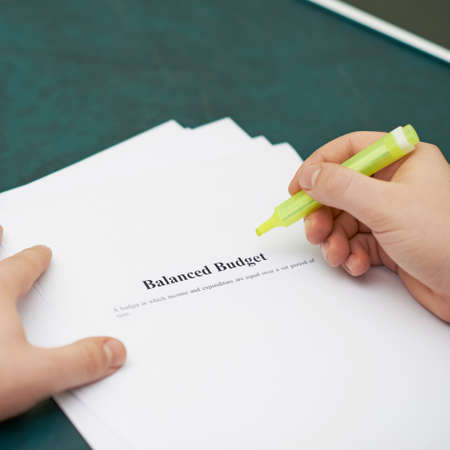 balanced budget: Marking words in a balanced budget definition, shallow depth of field composition