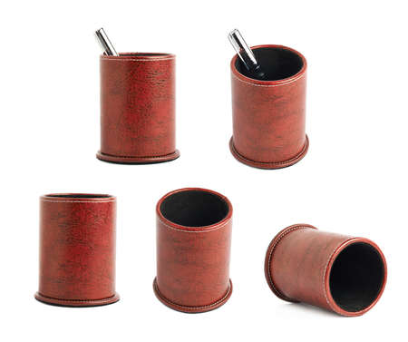 Red leather pen holder cylinder box isolated over the white background, set of five foreshortenings photo