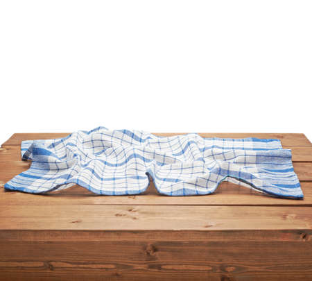 table surface: Blue tablecloth or towel over the surface of a brown wooden table, composition isolated over the white background Stock Photo
