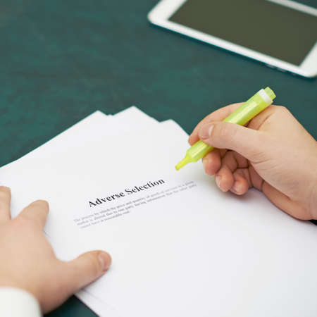 adverse: Marking words in an adverse selection definition, shallow depth of field composition Stock Photo