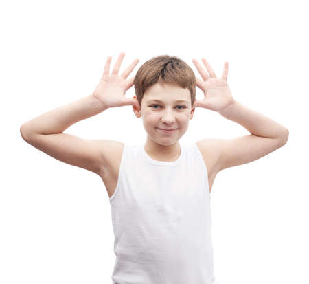 prankster: Happy young boy play the ape in a sleeveless white shirt, composition isolated over the white background