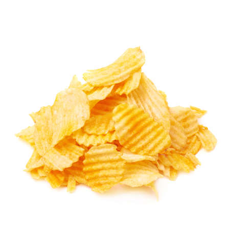fatty food: Pile of multiple ribbed wavy yellow potato chips snacks isolated over the white background