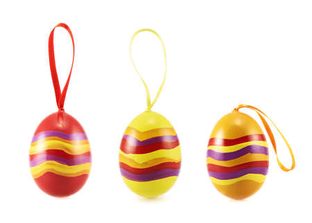 Colorful Easter egg with a loop ribbon isolated over the white background, set of three versions photo