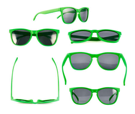 Green sun glasses isolated over the white background, set of six different foreshortenings photo