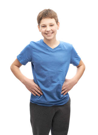 Laughing happy young boy in a blue t-shirt, portrait isolated over the white background