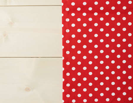 table surface: Red polka dot tablecloth or towel over the surface of a wooden table Stock Photo