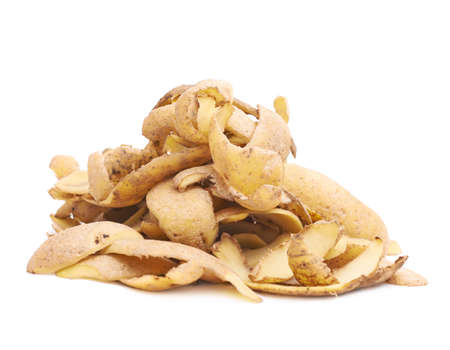 raw food: Pile of brown potato peels isolated over the white background