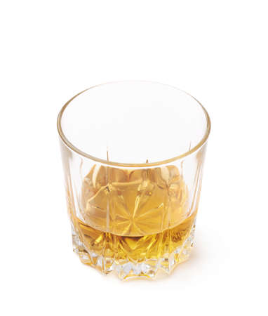 bourbon: Glass tumbler filled with whiskey bourbon isolated over the white background Stock Photo