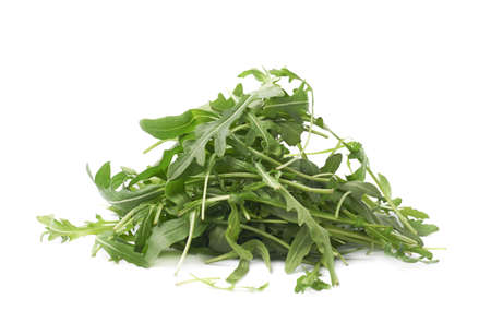 roquette: Pile of eruca sativa rucola arugula fresh green rocket salad leaves, composition isolated over the white  Stock Photo