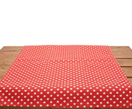 dot surface: Red polka dot tablecloth or towel over the surface of a brown wooden table, composition isolated over the white