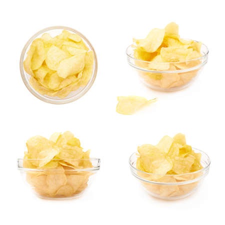 potato chips: Multiple yellow potato chips snacks in a glass bowl, composition isolated over the white , set of four different foreshortenings Stock Photo