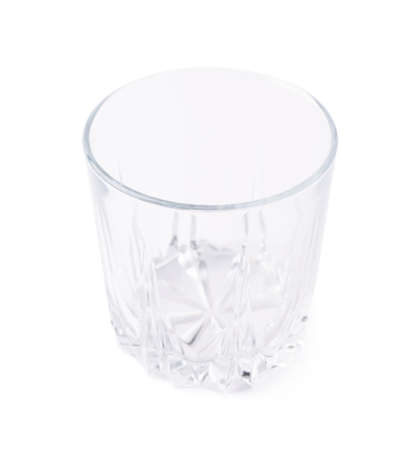 tumbler glass: Empty whiskey tumbler glass isolated over the white