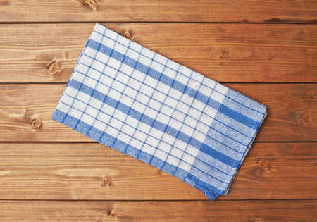 table surface: Blue tablecloth or towel over the surface of a brown wooden table Stock Photo