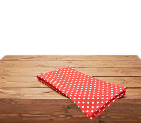 table surface: Red polka dot tablecloth or towel over the surface of a brown wooden table, composition isolated over the white background