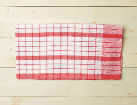 table surface: Red tablecloth or towel over the surface of a wooden table