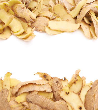 peels: Pile of brown potato peels isolated over the white