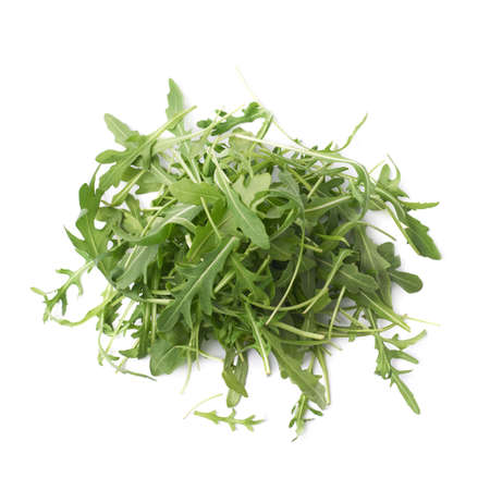 Pile of eruca sativa rucola arugula fresh green rocket salad leaves, composition isolated over the white background Banque d'images
