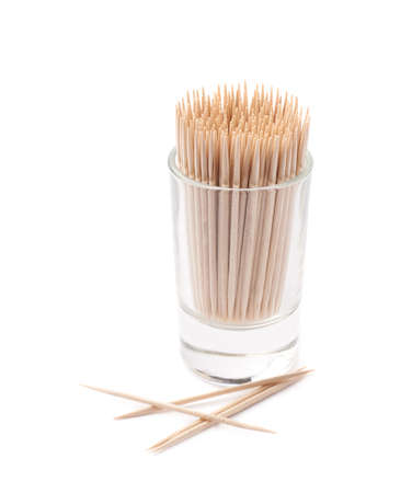 toothpick: Glass shot filled with the wooden toothpicks isolated over the white background