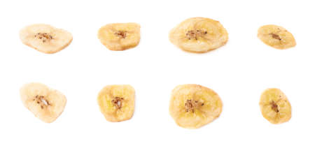 banana slice: Set of multiple dried banana slices snacks isolated over the white background Stock Photo