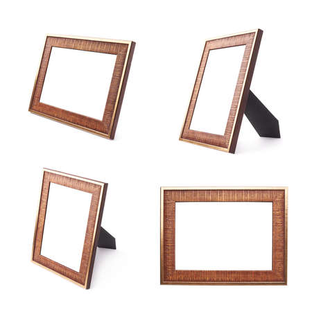 Wooden copyspace empty picture frame isolated over the white background photo