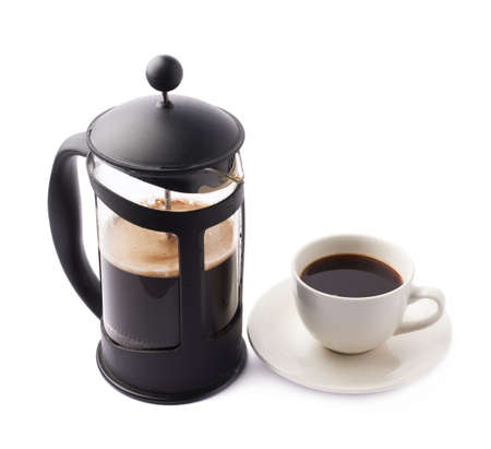 french: French press coffee pot next to cup of coffee, composition isolated over the white background