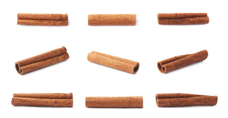 christmas scent: Set of multiple single cinnamon sticks isolated over the white background Stock Photo