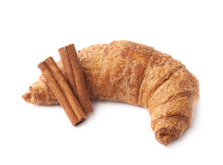 Croissant pastry and cinnamon sticks composition isolated over the white background photo