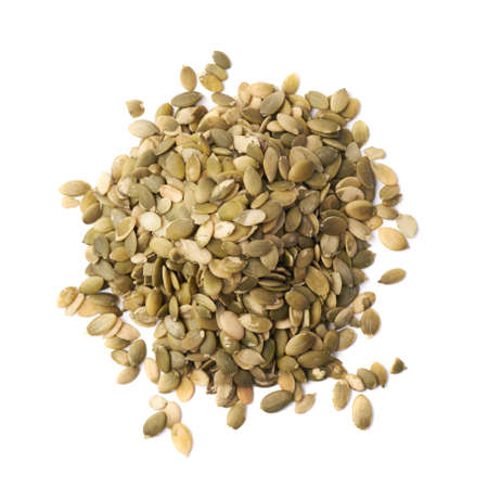 Pile of pumpkin seeds isolated over the white background photo