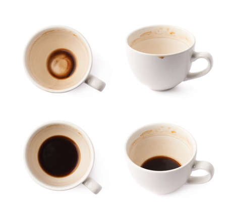 multiple stains: Used empty cup of coffee covered with multiple stains, isolated over the white background, set of four foreshortenings Stock Photo