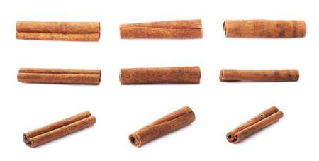 Set of multiple single cinnamon sticks isolated over the white background Foto de archivo