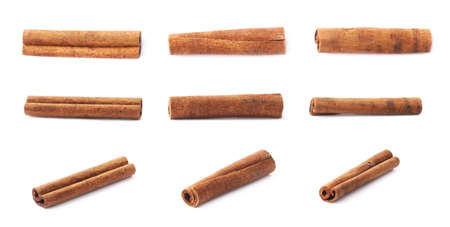 Set of multiple single cinnamon sticks isolated over the white background Standard-Bild
